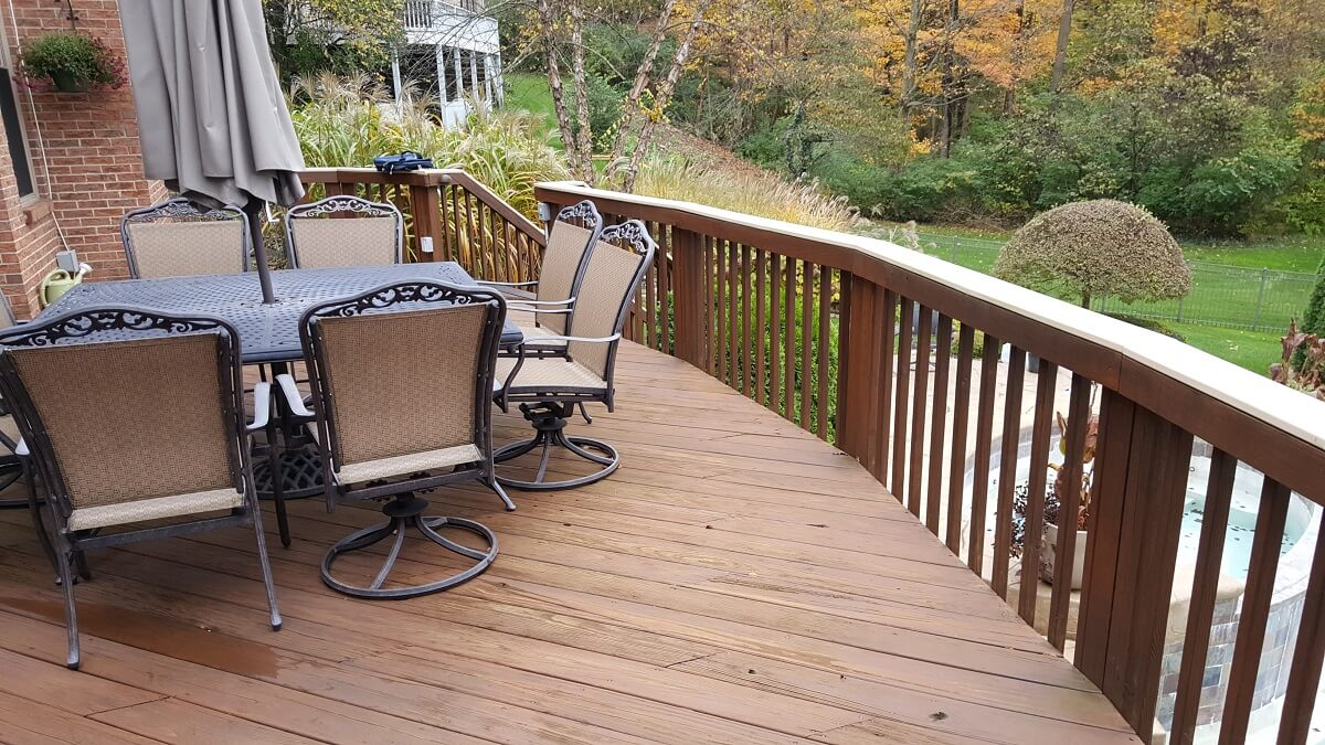 Existing second story deck with outdoor furniture, before the redecking began
